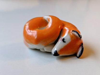 sleepy ceramic fox