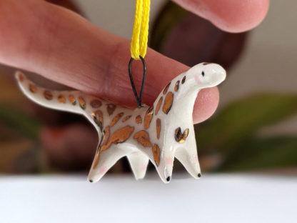 diplodocus doré pendentif