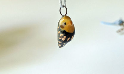 cockatiel ceramics gold pendant