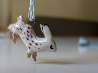 gold and clay bunny pendent