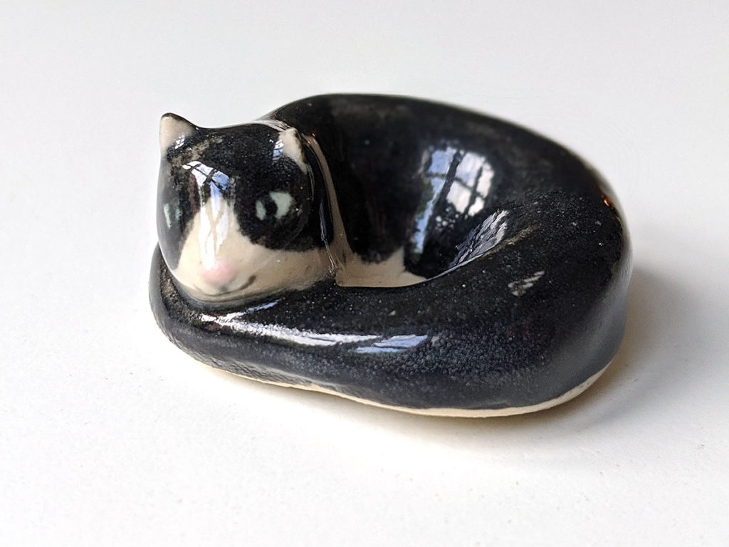 chat rond porcelaine