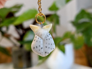 Spotted moth pendant