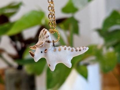 pendentif tricératops céramique et or