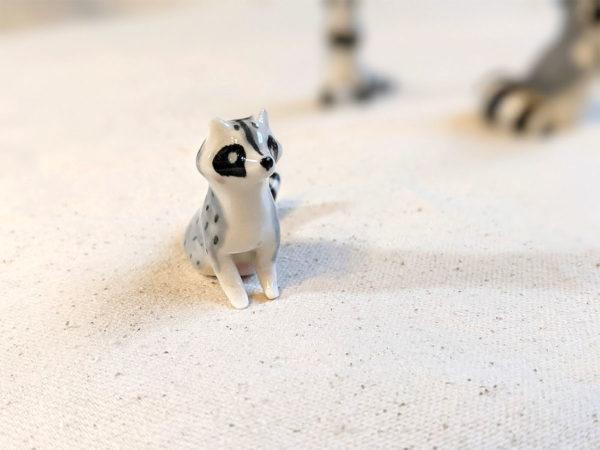 raton laveur porcelaine figurine