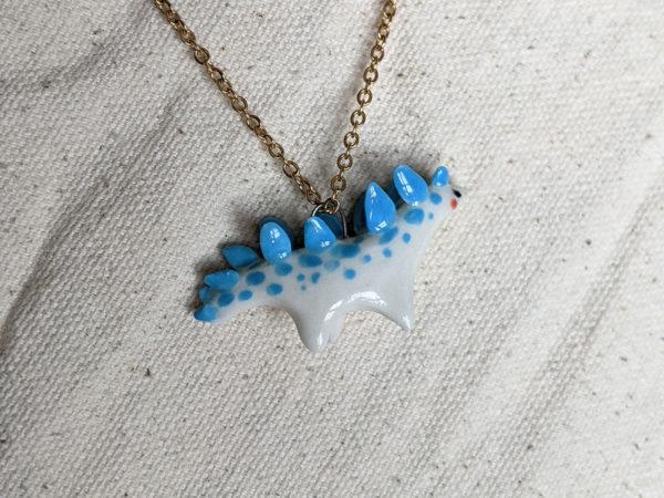 stegosaurus pendant blue