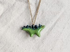 green stegosaurus pendant