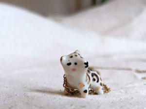 porcelain pendant snow leopard