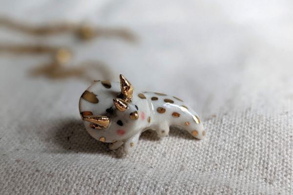 porcelain triceratops pendant kness