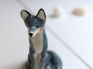 grey wolf figurine porcelain