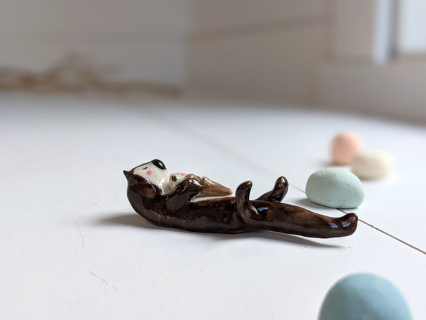 porcelain otter mom and baby figurine