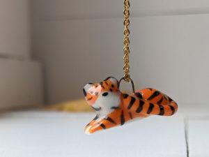 porcelain pendant lying tiger