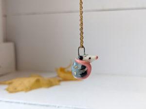porcelain pendant opossum
