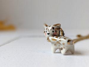 porcelain pendant snow leopard tail