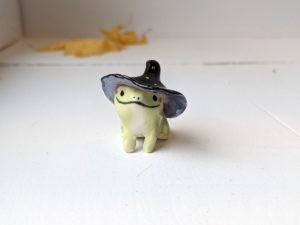porcelain witch frog figurine